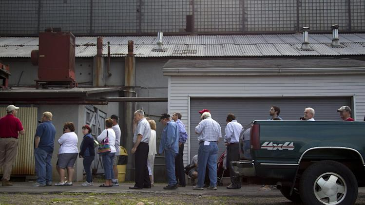 People wait in line to hear Republican presidential candidate, former Massachusetts Gov. Mitt Romney speak during a campaign stop at Weatherly Casting Company in Weatherly, Pa., Saturday, June 16, 2012.  (AP Photo/Evan Vucci)