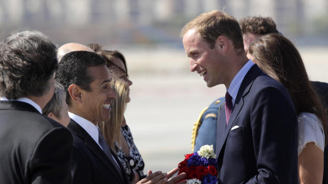 Prince William and Kate, the Duke and Duchess of Cambridge, are greeted by Los Angeles Mayor Antonio Villaraigosa, center left, as they arrive at Los Angeles International Airport in Los Angeles on Friday, July 8, 2011. (AP Photo/Jae C. Hong)