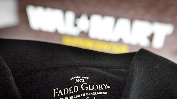 This photo illustration made Wednesday, Dec. 12, 2012, shows the label of a garment made in Bangladesh displayed outside the Wal-Mart store where it's sold, in Atlanta. Wal-Mart Stores Inc. is alerting its global suppliers that it will immediately drop them if they subcontract their work to factories that haven't been authorized by the discounter. (AP Photo/David Goldman)