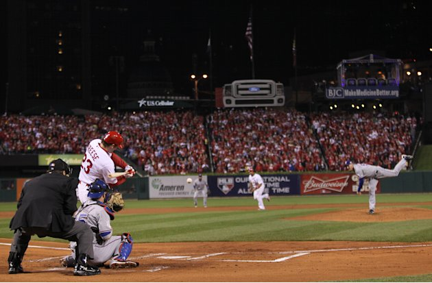 St. Louis Cardinals' David Freese hits a two-run double during the first inning of Game 7 of baseball's World Series against the Texas Rangers Friday, Oct. 28, 2011, in St. Louis. (AP Photo/Ezra Shaw,