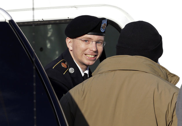 FILE - In a Wednesday, Nov. 28, 2012 file photo, Army Pfc. Bradley Manning, center, steps out of a security vehicle as he is escorted into a courthouse in Fort Meade, Md., for a pretrial hearing. Manning is charged with aiding the enemy by causing hundreds of thousands of classified documents to be published on the secret-sharing website WikiLeaks. He acknowledged in pretrial testimony on Friday, Nov. 30, 2012 that he tied a bedsheet into a noose and contemplated suicide after he was first arrested. His testimony appeared to support the militarys argument that it was trying to protect Pfc. Bradley Manning from himself by keeping him under strict isolation. Mannings defense team argues the conditions he experienced for nine months at the Marine Corps brig in Quantico, Va., were too harsh, well past the time he was still having suicidal thoughts, and his charges should be dropped because of it. (AP Photo/Patrick Semansky)