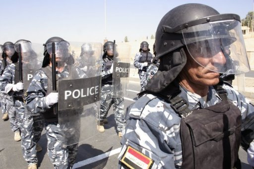 Iraqi police take part in a parade in the northern city of Mosul in 2009. Shootings and bombings in Iraq on Tuesday killed four people, including an anti-corruption investigator, security and medical officials said