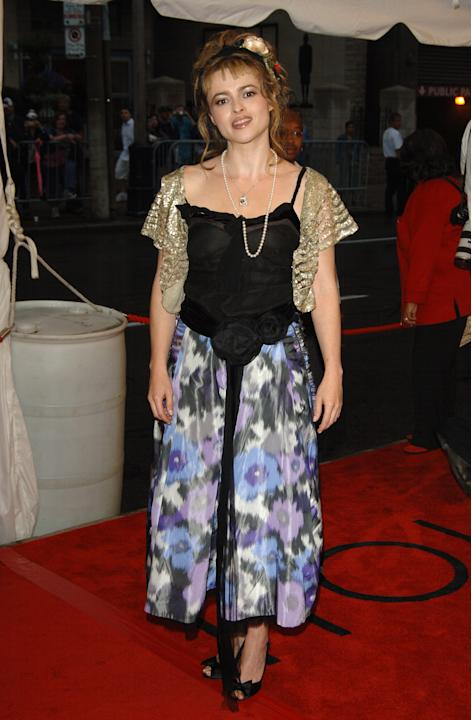 Helena in a watercolor skirt and gold shrug