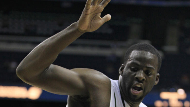 Long Island's Jamal Olasewere, front, drives past Michigan State's Draymond Green during the second half of an NCAA men's college basketball tournament second-round game  in Columbus, Ohio, Friday, March 16, 2012.  Michigan State won 89-67. (AP Photo/Tony Dejak)