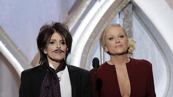 This image released by NBC shows co-hosts Tina Fey, left, and Amy Poehler on stage during the 70th Annual Golden Globe Awards at the Beverly Hilton Hotel on Jan. 13, 2013, in Beverly Hills, Calif. (AP Photo/NBC, Paul Drinkwater)