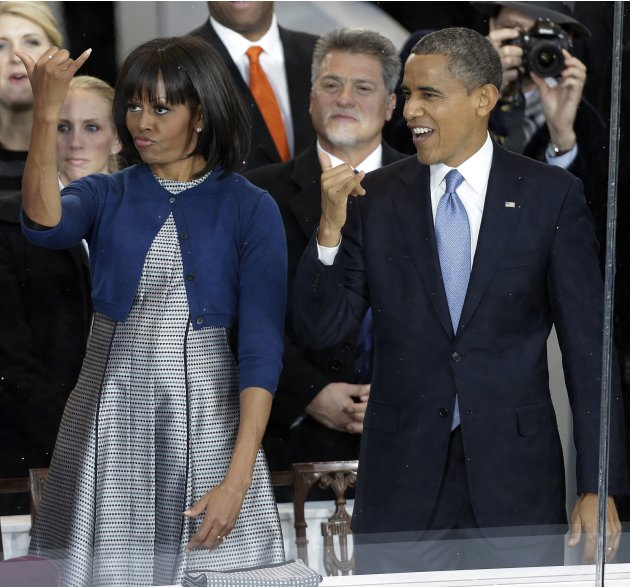 President Barack Obama and first lady Michelle Obama greet the Hawaii Home State Float during the inaugural parade Monday, Jan. 21, 2013, in Washington. Thousands  marched during the 57th Presidential