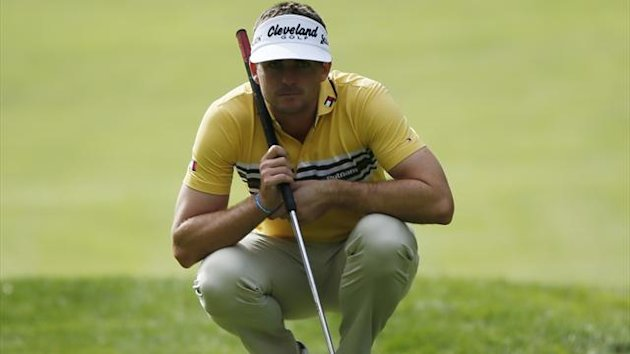 Keegan Bradley lines up a putt with a long putter on the first green during the Pro-Am round of the World Challenge golf tournament
