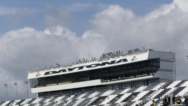 Juan Pablo Montoya, of Colombia, drives to his garage from the track during the final practice for the NASCAR Daytona 500 Sprint Cup Series auto race at Daytona International Speedway, Saturday, Feb. 23, 2013, in Daytona Beach, Fla. (AP Photo/John Raoux)