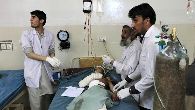 A boy receives treatment at a hospital after a suicide attack in Jalalabad