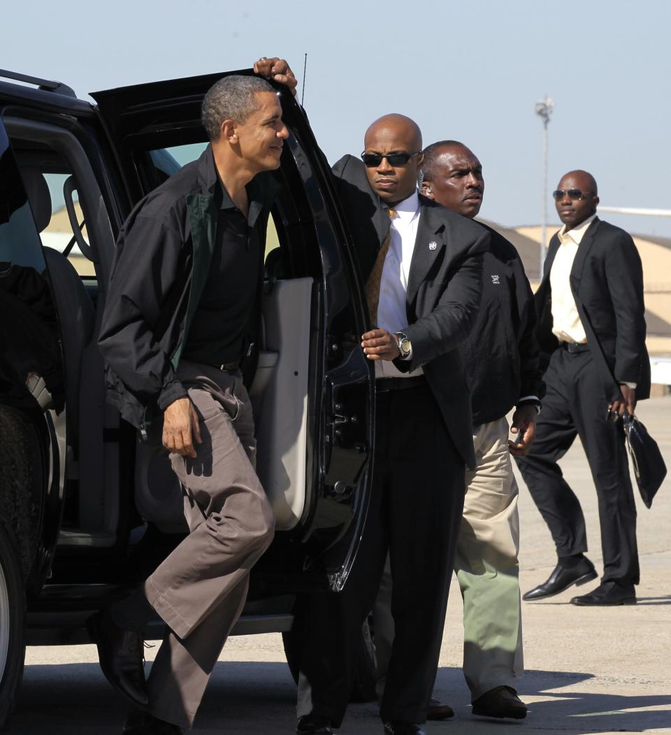 President Barack Obama walks to board Air Force One at Andrews Air Force Base in Maryland outside Washington, Sunday, Oct. 17, 2010. With only two weeks to critical midterm elections, Obama is traveling to Ohio to muster support for Democratic candidates, including Governor Ted Strickland. (AP Photo/J. Scott Applewhite)