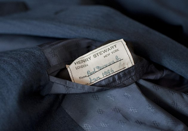 "A tailor's tag with the name ""Paul Newman"" is seen on a suit found by Peter Gamlen in the basement of his apartment in New Haven, Conn., Tuesday, Oct. 9, 2012. Gamlen believes the suit belonged to the actor. (AP Photo/Jessica Hill)"
