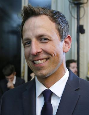 American talk show host Seth Meyers poses for photographers prior to Valentino men's Spring-Summer 2015 fashion collection presented in Paris, Wednesday, June 25, 2014. (AP Photo/Michel Euler)
