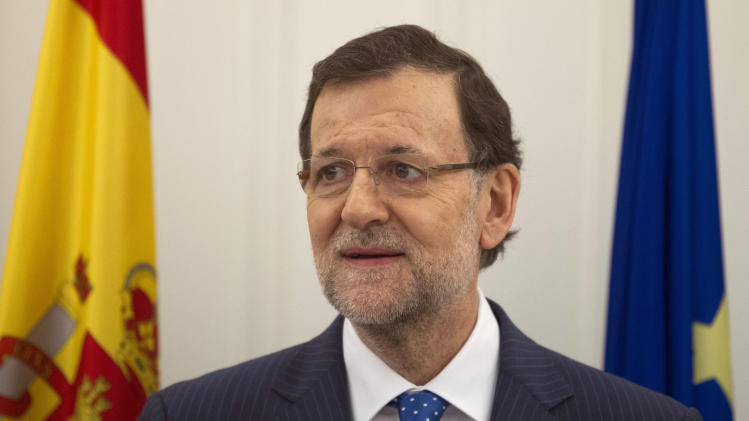 Spain's Prime Minister Mariano Rajoy attends a bilateral signing with Poland at the Moncloa Palace in Madrid, Spain, Monday, July 15, 2013. Conservative Spanish Prime Minister Mariano Rajoy is certain to face a barrage of questions in a press conference following newspaper publication of alleged text message exchanges between him and a now jailed former party treasurer that have prompted opposition demands for the premier to resign. (AP Photo/Paul White)