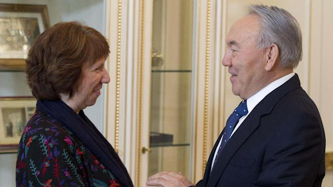 EU foreign policy chief Catherine Ashton, left, and Kazakhstan's President Nursultan Nazarbayev greet each other prior their talks in Almaty, Kazakhstan, Monday, Feb. 25, 2013.  Iran and six world powers, five permanent U.N. Security council members and Germany, are set to hold talks in Kazakhstan this week on Tehran's controversial nuclear program.(AP Photo/Pavel Mikheyev)