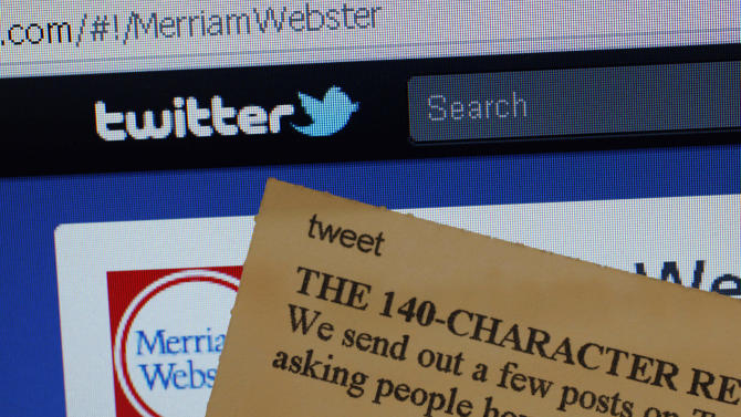 """This Wednesday, Aug. 24, 2011 photo displays an index card with the entry """"tweet"""" next to a computer screen showing the Twitter website,  at the Merriam-Webster headquarters in Springfield, Mass.  Used as both a noun and a verb, the word describing a post made on the online Twitter message service is among more than 100 new terms revealed Thursday for the dictionary publisher's newest edition.  (AP Photo/Charles Krupa)"""