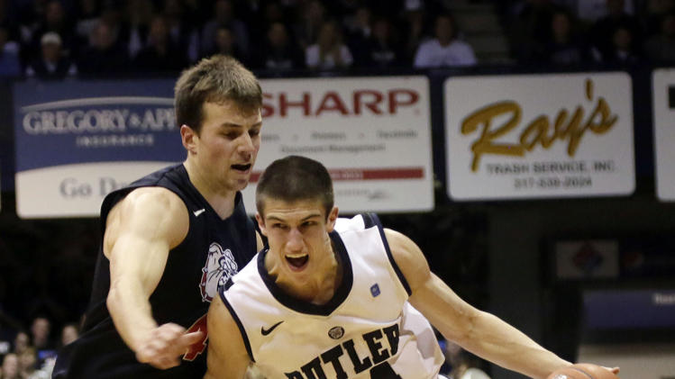 Butler guard Kellen Dunham, right, drives around Gonzaga guard Kevin Pangos during the first half of an NCAA college basketball game Saturday, Jan. 19, 2013, in Indianapolis. (AP Photo/AJ Mast)