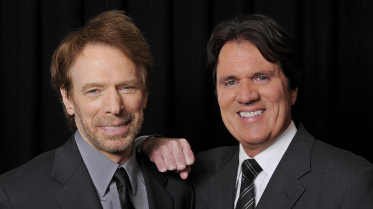 "Jerry Bruckheimer, left, producer of the upcoming Disney film ""Pirates of the Caribbean: On Stranger Tides,"" poses with the film's director Rob Marshall backstage at CinemaCon 2011, Tuesday, March 29, 2011, in Las Vegas. (AP Photo/Chris Pizzello)"