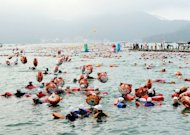 About 30,000 swimmers cross the Sun Moon Lake along a 3.3-kilometre (2.2 mile) route. Organisers said the annual swimming event drew an estimated 28,400 swimmers, including more than 1,300 from China
