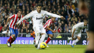 Real Madrid's Cristiano Ronaldo from Portugal, second left, scores a goal during the Spanish La Liga soccer match against Atletico de Madrid at the Santiago Bernabeu stadium, in Madrid, Spain, Saturday, Nov. 26, 2011. (AP Photo/Andres Kudacki)
