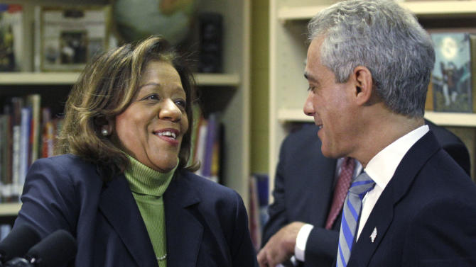 """Newly appointed Chicago Public Schools CEO Barbara Byrd-Bennett, shakes hands with Chicago Mayor Rahm Emanuel at a news conference, Friday, Oct. 12, 2012, in Chicago. Emanuel replaced his embattled public schools chief Jean-Claude Brizard with Bennett, a veteran educator and administrator whose experience in Cleveland, Detroit and New York will help take Chicago school reforms """"to the next level."""" (AP Photo/M. Spencer Green)"""