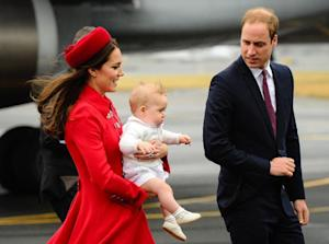 Prince William and his wife Kate, carrying baby Prince…