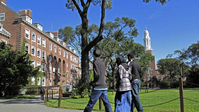 In this Friday, Oct. 7, 2011 photo, people walk on the campus of Brooklyn College in the Brooklyn borough of New York. Investigators have been infiltrating Muslim student groups at Brooklyn College and other schools in the city, monitoring their Internet activity and placing undercover agents in their ranks, police documents obtained by The Associated Press show. Legal experts say the operation may have broken a 19-year-old pact with the colleges and violated U.S. privacy laws, jeopardizing millions of dollars in federal research money and student aid. (AP Photo/Bebeto Matthews)