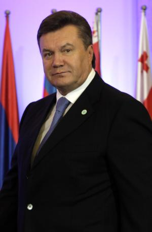Ukraine's President Viktor Yanukovych arrives for the Eastern Partnership Council Summit in Warsaw on Friday, Sept. 30, 2011. Poland welcomes European Union leaders on Friday for what is expected to be a key event of its EU presidency: a summit aimed at keeping alive the prospect of the bloc's eastward enlargement. The summit in Warsaw is to focus heavily on Ukraine, which has been negotiating free trade and association agreements with the EU, a milestone for the former Soviet state in its hoped-for path toward deeper integration with its wealthier neighbors. (AP Photo/Virginia Mayo)