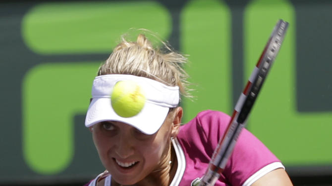 Elena Vesnina, of Russia, returns to Maria Sharapova, also of Russia, during the Sony Open tennis tournament in Key Biscayne, Fla.,  Sunday, March 24, 2013. (AP Photo/Alan Diaz)