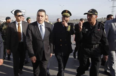 Tunisia's PM Jomaa inspects Tunisian police standing guard on the eve of presidential elections, in Beja