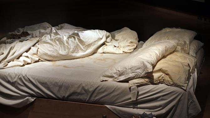 British artist Tracey Emin 1998 artpiece, entitled 'My Bed' on display, at an auction house exhibition space in central London, Friday, June 27, 2014. It will be part of Christie's Post-War & Contemporary Art Evening Auction on July 1, 2014 and is estimated to fetch around 800,000–1.2 million British pounds, ($1,36-2,04 million , euro999,000 thousand-1,49 million). (AP Photo/Lefteris Pitarakis)