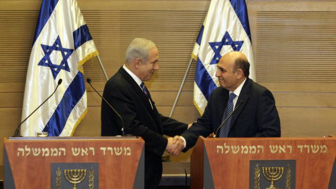 "Jerusalem : Israel's Prime Minister Benjamin Netanyahu, left, and Kadima party leader Shaul Mofaz shake hands before holding a joint press conference announcing the new coalition government, in Jerusalem, Tuesday, May 8, 2012. Netanyahu said Tuesday his new coalition government will promote a ""responsible"" peace process with the Palestinians. AP/PTI(AP5_8_2012_000121A)"