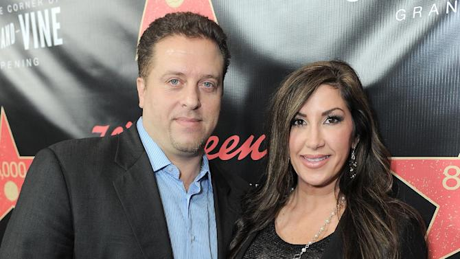"FILE - This Nov. 30, 2012 file photo originally released by Walgreens shows Chris Laurita, left, and his wife Jacqueline Laurita, of ""The Real Housewives of New Jersey,"" at Walgreens 8000th Store Opening in Los Angeles. Authorities say a man who told police that he was an attorney for the Lauritas falsely represented himself as a lawyer. A Paramus man claims Jacqueline and Christopher Laurita and Giuseppe ""Joe"" Gorga attacked him as cameras rolled in Ridgewood on March 30. John Karagiorgis filed a complaint, accusing the three of simple assault and making terroristic threats. (AP Photo/Walgreens, Jordan Strauss, file)"