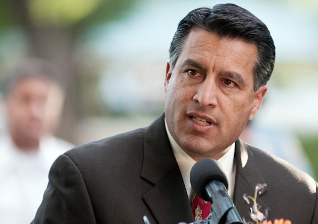 FILE - In this Sept. 25, 2011 file photo Nevada Gov. Brian Sandoval speaks during a memorial service in Reno, Nev. Sandoval, along with New Mexico Gov. Susana Martinez, will head up a new Republican effort to recruit Hispanic and female candidates for state offices across the country. (AP Photo/Kevin Clifford,File)