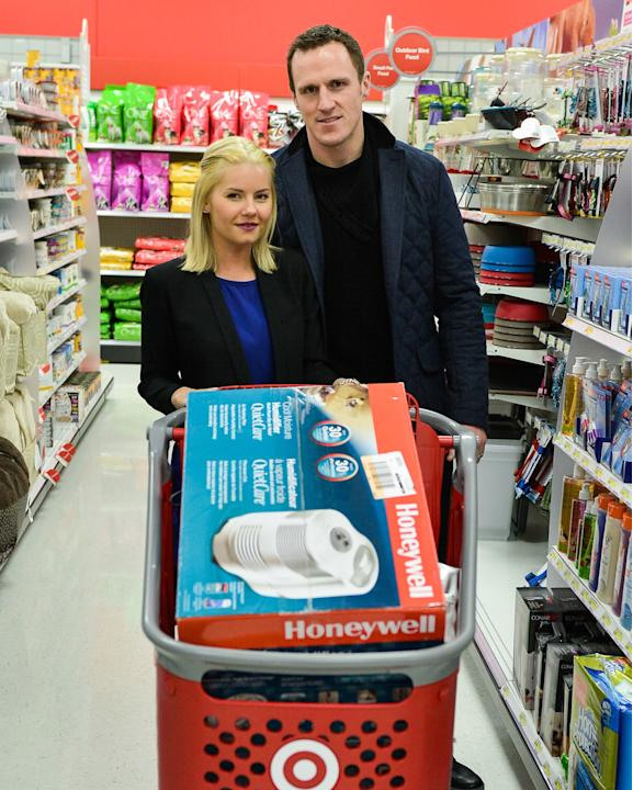 Professional Hockey Player Dion Phaneuf And His Wife Actress Elisha Cuthbert Make In-Store Holiday Appearance At Target