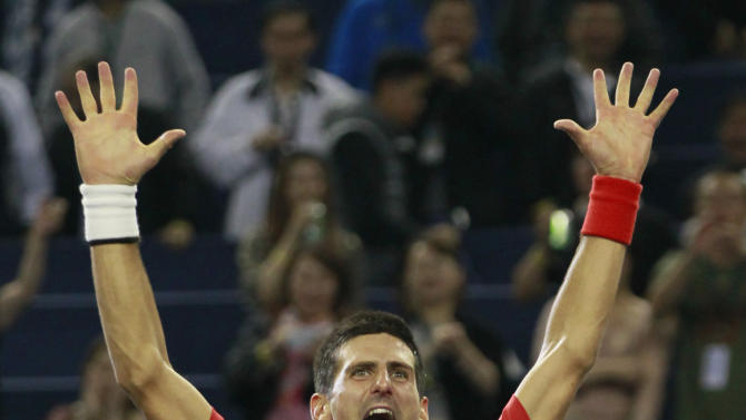 Novak Djokovic of Serbia celebrates after beating Andy Murray of Britain 5-7, 7-6 (11), 6-3 in their men's singles final march at the Shanghai Masters tennis tournament at Qizhong Forest Sports City Tennis Center in Shanghai, China, Sunday Oct. 14, 2012. (AP Photo/Eugene Hoshiko)