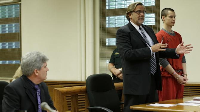 """Colton Harris-Moore, right, who is also known as the """"Barefoot Bandit,"""" stands in a Skagit County Superior Courtroom, Wednesday, May 8, 2013, in Mount Vernon, Wash., as his attorney, John Henry Browne, second from right, speaks, and Skagit County Deputy Prosecutor Eric Peterson, left, looks on. Harris-Moore pleaded guilty Wednesday to a burglary charge for stealing an airplane and flying it to Orcas Island, Wash., but as part of a plea deal with Skagit County Prosecutor Rich Weyrich, the 22-year-old was sentenced to three months he's already spent in jail and he will return to serving his seven-year prison sentence for other crimes. (AP Photo/Ted S. Warren)"""