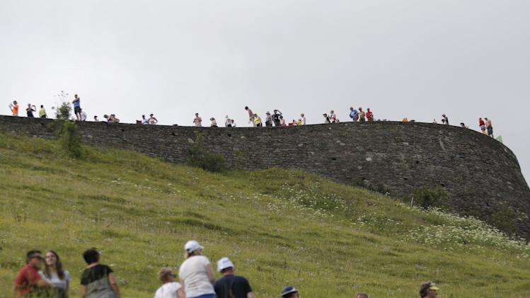 Spectators wait for the riders to pass Peyresourde pass during the seventeenth stage of the Tour de France cycling race over 124.5 kilometers (77.4 miles) with start in Saint-Gaudens and finish in Saint-Lary, France, Wednesday, July 23, 2014