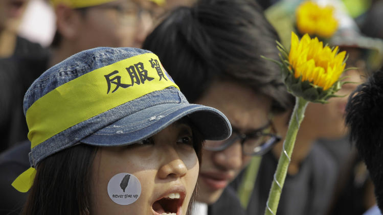 Thousands in Taiwan protest China trade deal