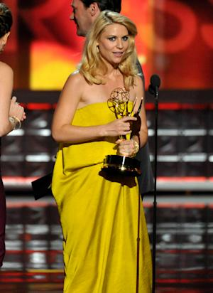 "Claire Danes accepts the award for outstanding lead actress in a drama series for ""Homeland"" at the 64th Primetime Emmy Awards at the Nokia Theatre on Sunday, Sept. 23, 2012, in Los Angeles. (Photo by John Shearer/Invision/AP)"