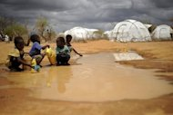 Children fetch water at the sprawling Dadaab refugee complex in Kenya. Gunmen killed at least one person and kidnapped an aid worker in Kenya's Dadaab refugee camp, close to the border with war-torn Somalia, police sources and the Red Cross said Friday