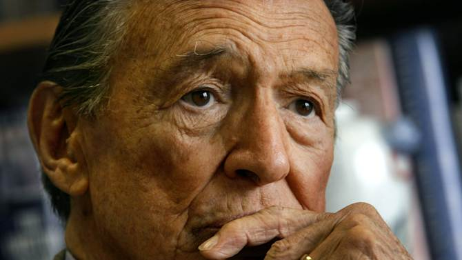 "FILE  - This May 8, 2006 file photo shows Mike Wallace, longtime CBS ""60 Minutes"" correspondent, during an interview at his office in New York.  Wallace, famed for his tough interviews on ""60 Minutes,"" has died, Saturday, April 7, 2012. He was 93. (AP Photo/Bebeto Matthews, File)"