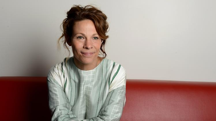 "This Monday July 15, 2013 photo shows actress Lili Taylor posing for a portrait in Los Angeles. Taylor stars in the haunted-house thriller ""The Conjuring,"" opening nationwide on Friday, July 19. (Photo by Jordan Strauss/Invision/AP)"