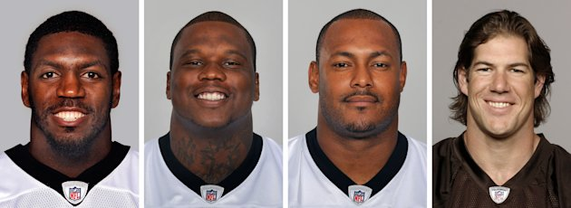 FILE - From left are NFL football players Jonathan Vilma, in 2011; Anthony Hargrove, in 2010; Will Smith, in 2011; and Scott Fujita, in 2011. All four players punished in the NFL's bounty investigation have filed appeals with the league. People familiar with the situation say the players have asked Commissioner Roger Goodell to remove himself as arbitrator because they do not believe he can be impartial. (AP Photo/File)
