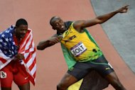 Gold medalist Jamaica&#39;s Usain Bolt (R) celebrates with bronze medalist USA&#39;s Justin Gatlin (L) after winning the men&#39;s 100m final at the athletics event during the London 2012 Olympic Games in London