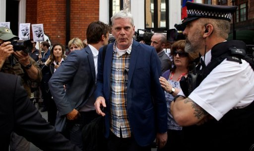 <p>Icelandic journalist and WikiLeaks spokesperson Kristinn Hrafnsson (C) leaves the Ecuador embassy building in central London on June 20. , where WikiLeaks founder Julian Assange is holed up seeking asylum. Ecuador will take its time in deciding whether to grant political asylum to Assange over fears he risks the death penalty in the US, its president said</p>