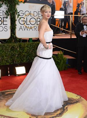 Jennifer Lawrence arrives at the 71st annual Golden Globe Awards at the Beverly Hilton Hotel on Sunday, Jan. 12, 2014, in Beverly Hills, Calif. (Photo by Jordan Strauss/Invision/AP)
