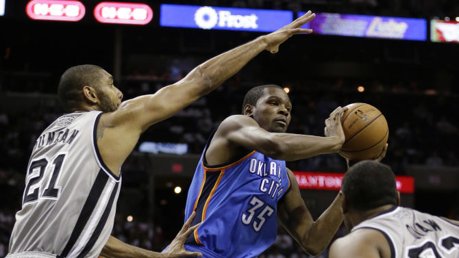 Oklahoma Thunder's Kevin Durant (35) looks to pass the ball as San Antonio Spurs' Tim Duncan (21) and Boris Diaw, right, of France, defend during the third quarter of an NBA basketball game, Thursday, Nov. 1, 2012, in San Antonio. (AP Photo/Eric Gay)