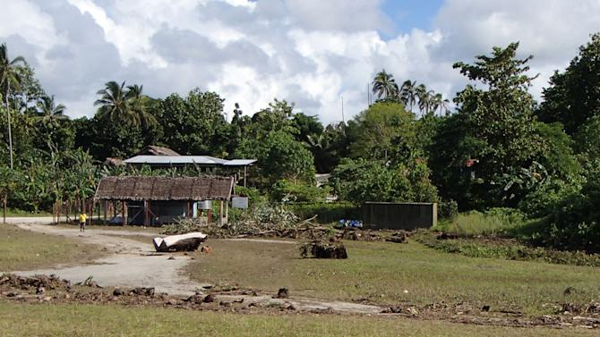 Debris litters the partially destroyed Lata Airport, Solomon Islands,  following a Tsunami Wednesday Feb. 6, 2013.  The damage seen is part of a survey by the assessment crew of the aid organisation World Vision.  Solomon Islands authorities say at least four people are missing and presumed dead after an earthquake triggered a tsunami, with waves of up to 5 feet hitting the western side of Santa Cruz Island and damaged up to 80 properties. Dozens of aftershocks have followed. Other tsunami warnings are canceled. (AP Photo / World Vision)