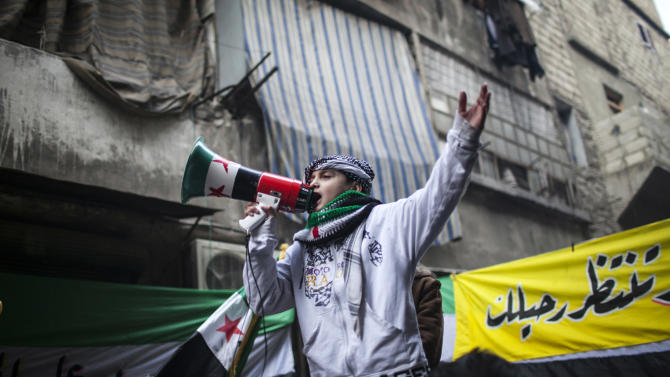 A child uses a megaphone to lead others in chanting Free Syrian Army slogans during a demonstration in the neighborhood of Bustan Al-Qasr, Aleppo, Syria, Friday, Jan. 4, 2013. The U.N. said Wednesday that more than 60,000 people have been killed since Syria's crisis began in March 2011 — a figure much higher than previous opposition estimates. (AP Photo/Andoni Lubaki)