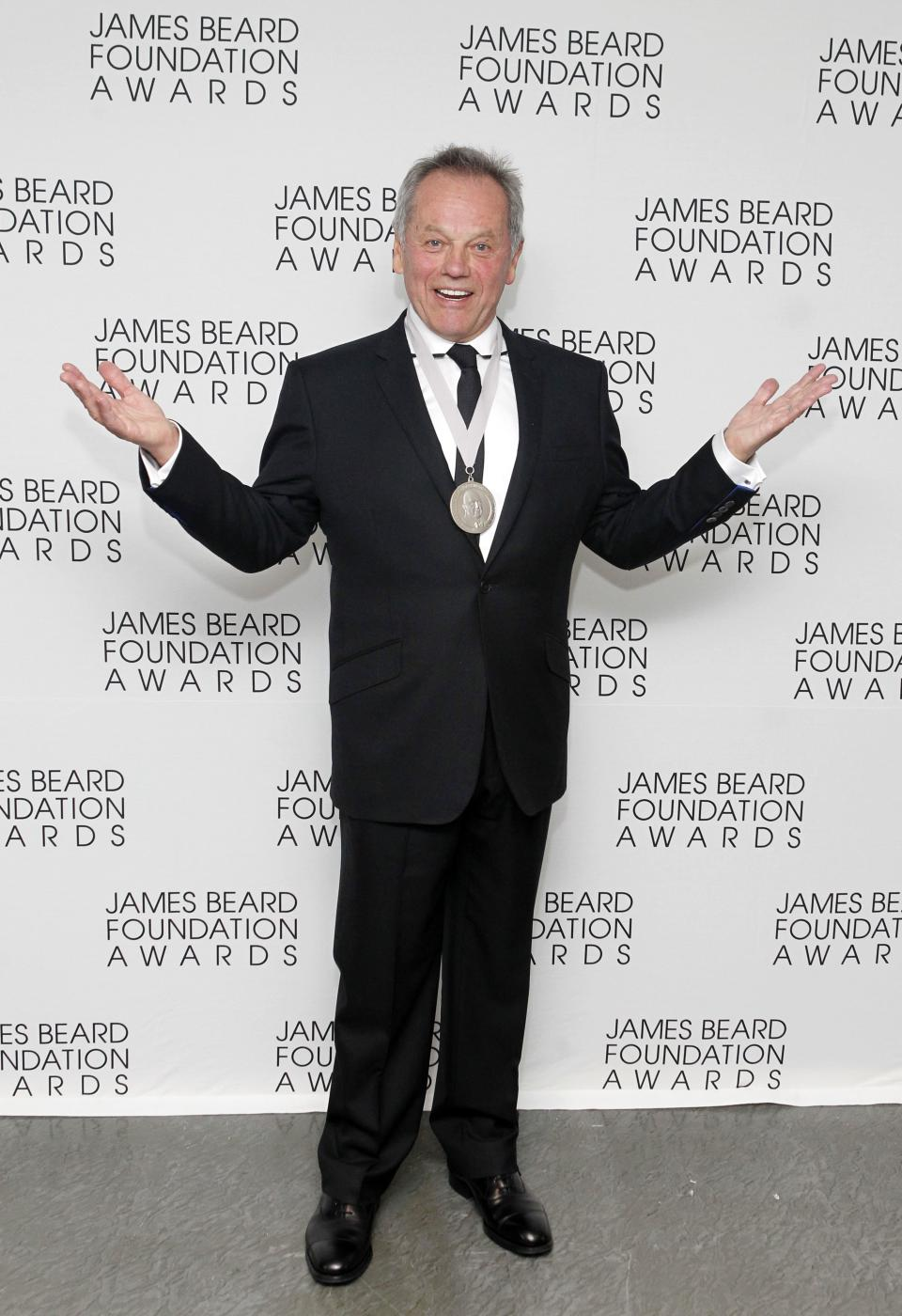 Chef Wolfgang Puck poses with his Lifetime Achievement Award during the James Beard Foundation Awards, Monday, May 7, 2012, in New York. (AP Photo/Jason DeCrow)